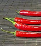 Glühender Chili Peppers Stockfotos