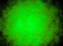 Glühender grüner Felsenhintergrund Lizenzfreie Stockfotografie