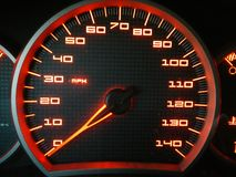 Glühender roter Geschwindigkeitsmesser Stockbilder