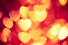 Glühender roter Herzhintergrund Stockfoto