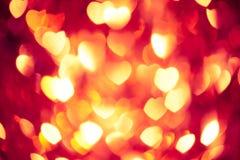 Glühender roter Herzhintergrund Lizenzfreie Stockfotografie