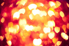 Glühender roter Herzhintergrund Stockfotos