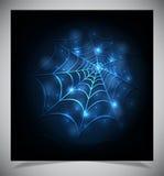 Glühendes Spinnennetz auf einem dunklen Hintergrund Stockbilder
