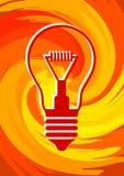 Glühlampe auf orange Hintergrund Stockfotografie