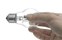 Glühlampe in einer Hand Lizenzfreies Stockbild