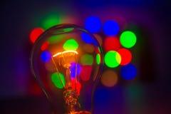 Glühlampe im bokeh lizenzfreies stockfoto