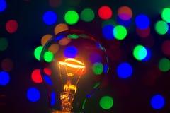 Glühlampe im bokeh lizenzfreie stockbilder