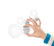 Glühlampe mit der Hand Stockfotografie
