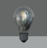 Glühlampe mit Kreuz Stockfoto