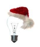 Glühlampe mit Weihnachtsschutzkappe Stockfotografie