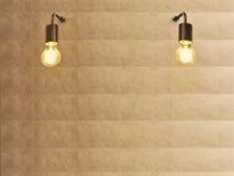 Glühlampe- und Goldbeschaffenheitswand stockfotografie