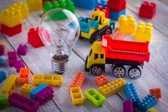 Glühlampe- und LKW-Spielzeug jpg Stockbild