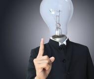 Glühlampekopf des Geschäftsmannes lizenzfreie stockfotos