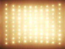 Glühlampen der Hunderte im orange Ton Stockbilder