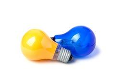 Glühlampen Gelb und Blau lizenzfreies stockbild