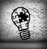Glühlampepuzzlespiel an Ziegelstein gezeichneter Wand stock abbildung