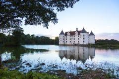 Glücksburg water castle at sunset Stock Images