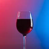 Glace avec le vin rouge Photographie stock