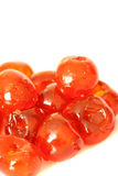 Glace cherries C. Photograph of glace cherries isolated against a white background Royalty Free Stock Photo