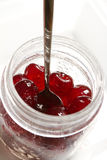 Glace cherries ingredients in a vintage jar on white. Background Royalty Free Stock Photos