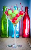 Glace cherries in martini glass. On the wooden table Stock Images