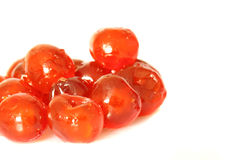 Glace cherries A. Photograph of glace cherries isolated against a white background Royalty Free Stock Image