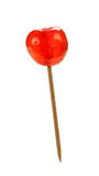 Glace cherry on stick, isolated Royalty Free Stock Images