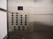 Glace d'ascenseur d'immeuble de bureaux et acier inoxydable Photos libres de droits
