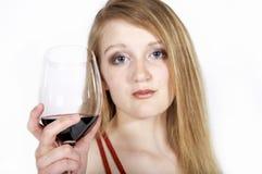 Glace de vin de prise de femme Images libres de droits