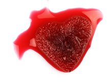 Glace en forme de coeur rouge dans le sang Photographie stock libre de droits