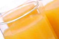 Glaces avec le jus d'orange Photo stock