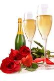 Glaces de Champagne avec les roses rouges et peu de coeur Image stock