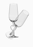 Glaces de champagne de couples de cheminée de coeur photo libre de droits