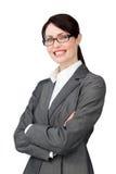 Glaces s'usantes de femme d'affaires radiante images libres de droits