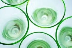 Glaces vertes transparentes sur le blanc Photographie stock