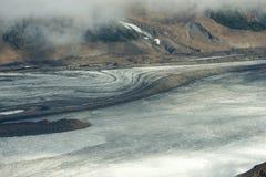 Glaciär och bergssida, Kluane nationalpark, Yukon Royaltyfria Bilder