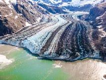 Glaciärfjärd: var glaciären möter havet Arkivfoton