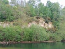 Glacial cliff. Lake sandstone norfolk royalty free stock photo