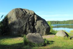 Glacial erratic boulders over the lake Royalty Free Stock Photography