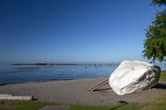 White Rock on beach gives its name to Vancouver suburb. A glacial erratic and the subject of local myth gives its name to the seaside community of White Rock stock photos
