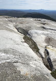 Glacial grooves in granite bedrock, legacy of the ice age. Royalty Free Stock Photos