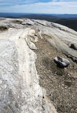 Glacial grooves in granite bedrock, legacy of the ice age. Royalty Free Stock Image