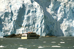 Glacial Ice Formation. A a tour boat takes tourist close to a glacier near Soldotna,alaska Stock Images