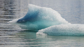 Glacial Ice. Iceberg in Grewing Glacier Lake melt away in the summer sun Stock Photography