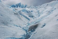 Glacial ice during trekking Perito Moreno Glacier - Argentina. Light blue glacial ice field during trekking Perito Moreno Glacier with water, peaks and cracks Royalty Free Stock Photos