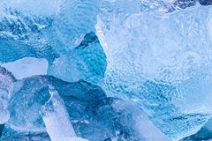 Glacial iceberg fragments floating in Arctic waters. Details of iceberg fragments floating in the arctic sea. Blue glacial ice calved from the g;aciers of stock photo