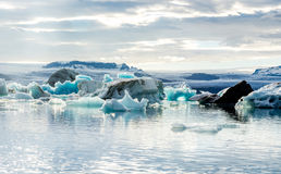 Glacial lagoon in Iceland, cloudy weather, mountains on the horizon. The glacial lake reflects the sky Royalty Free Stock Images