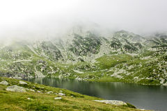 Glacial lake. Bucura lake is a glacier cirque lake, situated in the Retezat Mountains, in Romania Stock Photography