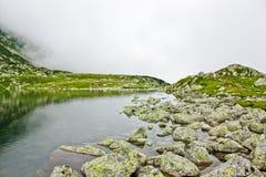 Glacial lake. Bucura glacial lake in National Park Retezat, Romania Royalty Free Stock Photography