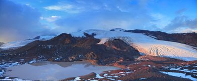 Glacial lake. On the background of melting glaciers of the southern slope of Elbrus stock photography
